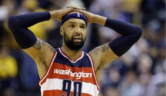 Washington Wizards forward Drew Gooden reacts after no foul was called on his shot during the second half of an NBA basketball game against the Indiana Pacers in Indianapolis, Tuesday, April 14, 2015. The Pacers defeated the Wizards 99-95 in double overtime. (AP Photo/Michael Conroy)