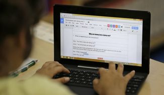 In this Thursday, March 12, 2015, photo, a fourth-grader uses Google docs to complete an exercise at Mira Vista School in Richmond, Calif. (AP Photo/Eric Risberg) ** FILE **