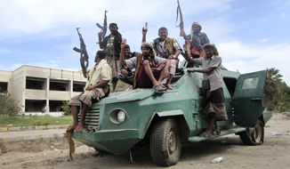 Militiamen loyal to President Abed Rabbo Mansour Hadi ride on an army vehicle on a street in Aden, Yemen, on March 20, 2015. Yemen's Shiite rebels, backed by supporters of former President Ali Abdullah Saleh, have seized the third-largest city after capturing the capital Sanaa in September, effectively splitting the country in half and hindering U.S. efforts to combat a powerful local al Qaeda affiliate. Hadi, a close U.S. ally, fled house arrest in Sanaa last month and has set up a base in the port city of Aden, the former capital of the once-independent south. (Associated Press) **FILE**