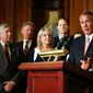 Members of Congress join House Speaker John Boehner of Ohio, right, as he speaks on Capitol Hill in Washington, Thursday, April 16, 2015, before signing a bipartisan bill which blocks a cut in Medicare payments that was due to take effect this month, and it revamps how physicians will be paid in the future. (AP Photo/Andrew Harnik)