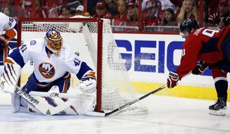 Washington Capitals left wing Marcus Johansson (90), from Sweden, can't make his shot go as New York Islanders goalie Jaroslav Halak (41), from Slovakia, defends during the first period of Game 2 of a first-round NHL hockey Stanley Cup playoff series, Friday, April 17, 2015, in Washington. (AP Photo/Alex Brandon)