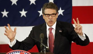 Former Texas Gov. Rick Perry speaks at a Republican Leadership Summit, Friday, April 17, 2015, in Nashua, N.H. (AP Photo/Jim Cole)