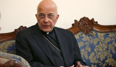 FILE - In this March 14, 2013 file photo, Cardinal Francis George speaks during an interview at the North American College in Rome. George, a vigorous defender of Roman Catholic orthodoxy who led the U.S. bishops' fight against Obamacare and played a key role in the church's response to the clergy sex abuse scandal, has died. He was 78. George, who retired as Chicago archbishop in the fall of 2014, died Friday morning, April 17, 2015, after a long fight with cancer, according to the Archdiocese of Chicago. (AP Photo/Michael Sohn, File)