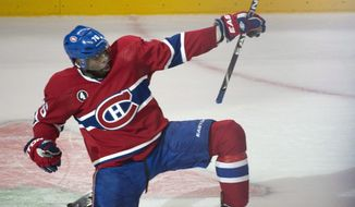 Montreal Canadiens' P.K. Subban celebrates his goal past Ottawa Senators goalie Andrew Hammond during the second period in Game 2 of an NHL hockey first-round playoff series, Friday, April 17, 2015 in Montreal. (Paul Chiasson/The Canadian Press via AP)  MANDATORY CREDIT **FILE**