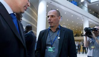 Greek Finance Minister Yanis Varoufakis speaks with members of the International Monetary Fund, before the IMF Governors group photo, at the World Bank-International Monetary Fund annual meetings in Washington, Saturday, April 18, 2015. ( AP Photo/Jose Luis Magana) ** FILE **