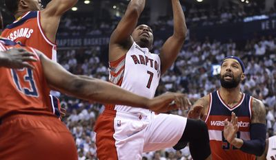 Toronto Raptors' Kyle Lowry (7) shoots against the Washington Wizards during the first half in Game 1 of the NBA basketball playoffs in Toronto, Saturday, April 18, 2015. (Frank Gunn/The Canadian Press via AP)   MANDATORY CREDIT