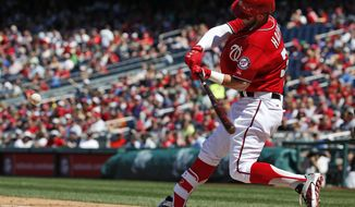 Washington Nationals' Bryce Harper hits a solo home run during the fifth inning of a baseball game against the Philadelphia Phillies at Nationals Park, Saturday, April 18, 2015, in Washington. (AP Photo/Alex Brandon)