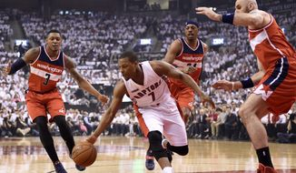 Toronto Raptors' Kyle Lowry (7) chases down a loose ball during the first half in Game 1 of an NBA basketball playoff game against the Washington Wizards in Toronto, Saturday, April 18, 2015. (Frank Gunn/The Canadian Press via AP)   MANDATORY CREDIT