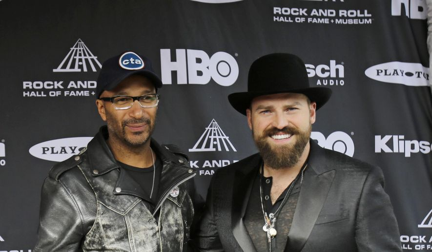 Tom Morello (left), formally of Rage Against the Machine, and Zac Brown arrive at the Rock and Roll Hall of Fame Induction Ceremony Saturday, April 18, 2015, in Cleveland. (AP Photo/Tony Dejak) ** FILE **