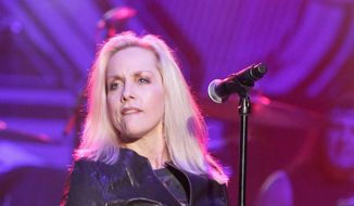 Cherie Currie spoke about the album, the death of her longtime mentor, Kim Fowley, a possible Runaways reunion and chain saws. (Associated Press)