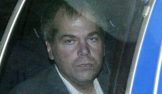 In this Nov. 18, 2003, file photo, John Hinckley Jr. arrives at U.S. District Court in Washington. (AP Photo/Evan Vucci, File)