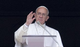"""Pope Francis waves to faithful from the window of his studio overlooking St. Peter's square during the Regina Coeli midday prayer, at the Vatican, Sunday, April 19, 2015. Referring to a boat crowded with migrants capsized in the sea north of Libya, Francis said:""""There are fears there could be hundreds of dead"""", then he bowed his head in silent prayer as did many of the tens of thousands in the crowd. (AP Photo/Andrew Medichini)"""