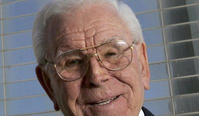 "FILE - In this Feb. 9, 2006, file photo, Robert H. Schuller poses outside the Crystal Cathedral in Garden Grove, Calif. Schuller, the Southern California televangelist who brought his message of ""possibility thinking"" to millions, died at age 88 on April 2, 2015. A public memorial will be held outside the glimmering cathedral he built in Southern California on Monday, April 20, 2015. The memorial service is open to the public. The church's campus has been bought by the Roman Catholic Diocese of Orange.(AP Photo/Chris Carlson, File)"