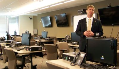 This March 9, 2012, file photo shows FBI spokesman Kyle Loven giving a tour of the Emergency Operations Center at the new Minneapolis-area field office in Brooklyn Center, Minn. Loven, spokesman for the Minneapolis office of the FBI, said six people were arrested Sunday, April 19, 2015, but gave no further details. An FBI spokesman in San Diego referred questions to Loven. (AP Photo/Amy Forliti, File)