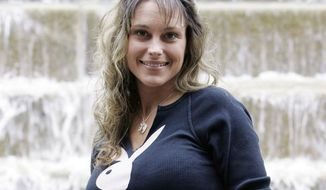 Michelle Manhart, shown here in 2007, was demoted from her sargeant position in the U.S. Air Force after posing in Playboy that year. (Associated Press/Eric Gay)