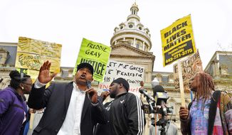 Edward Brown speaks at a protest outside City Hall about Freddie Gray in Baltimore, Monday, April 20, 2015. (Amy Davis/The Baltimore Sun via AP)