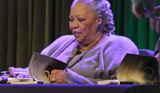 """In this Feb. 27, 2013 file photo, author Toni Morrison signs copies of her latest book """"Home,"""" during Google's online program series, Authors At Google, in New York. Morrison's latest book, """"God Help the Child,"""" will be released on Tuesday, April 21, 2015.  (AP Photo/Bebeto Matthews, File)"""