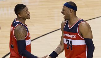 Washington Wizards forward Paul Pierce (34) celebrates with Washington Wizards guard Bradley Beal (3) after defeating the Toronto Raptors in Game 2 in the first round of the NBA basketball playoffs, Tuesday, April 21, 2015,  in Toronto. (Nathan Denette/The Canadian Press via AP)  MANDATORY CREDIT