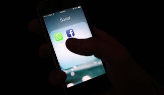 The Facebook app icon on an iPhone. (AP Photo/Karly Domb Sadof, File)