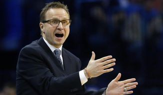 FILE - In this Feb. 25, 2015, file photo, Oklahoma City Thunder coach Scott Brooks gestures to his team during the fourth quarter of an NBA basketball game against the Indiana Pacers in Oklahoma City. The Thunder fired Brooks on Wednesday, April 22, 2015. (AP Photo/Sue Ogrocki, File0