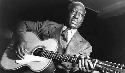 """Huddie William """"Lead Belly"""" Ledbetter, with his 12-string guitar, inspired Bob Dylan and Kurt Cobain."""