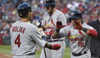 St. Louis Cardinals' Kolten Wong (16) celebrates his two-run home run with Yadier Molina (4) during the second inning of a baseball game against the Washington Nationals, Wednesday, April 22, 2015, in Washington. (AP Photo/Nick Wass)