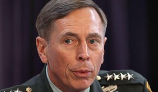 "In this Friday Oct. 15, 2010, file photo, Gen. David Petraeus, the top U.S and NATO commander addresses RUSI members on ""The International Mission in Afghanistan,"" at the United Services Institute in central London. Former CIA Director Petraeus, whose career was destroyed by an extramarital affair with his biographer, was expected to be sentenced Thursday April 23, 2015 in federal court in Charlotte for giving her classified material while she was working on the book. (AP Photo/Dan Kitwood, Pool, File)"