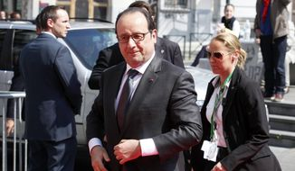 French President Francois Hollande, center, arrives for a meeting of the European Socialists prior to an emergency EU summit in Brussels on Thursday, April 23, 2015. (AP Photo/Francois Walschaerts) ** FILE **