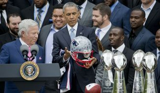 President Barack Obama looks over a signed New England Patriots football helmet presented to him by New England Patriots owner Robert Kraft, left, during a ceremony on the South Lawn of the White House in Wasington, Thursday, April 23, 2015, where the president honored the Super Bowl Champion New England Patriots for their Super Bowl XLIX victory. (AP Photo/Pablo Martinez Monsivais) **FILE**
