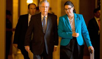 Senate Majority Leader Mitch McConnell of Ky. walks from his office to the Senate floor on Capitol Hill in Washington, Thursday, April 23, 2015, as the Senate is expected to vote on the nomination of Loretta Lynch as the next attorney general. The vote to confirm Ms. Lynch, who would be the first female African American Attorney General, has been delayed for over five months. (AP Photo/Andrew Harnik)