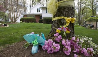 "Flowers and ribbons adorn a tree outside the Weinstein familyhouse in Rockville, Md., Thursday, April 23, 2015. Earlier, President Barack Obama took full responsibility for the counterterror missions and offered his ""grief and condolences"" to the families of the hostages, Warren Weinstein of Rockville, Maryland, and Giovanni Lo Porto who were inadvertently killed by CIA drone strikes early this year.  (AP Photo/Jose Luis Magana)"