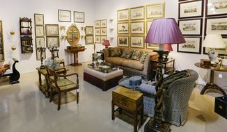 In this April 20, 2015 photo, household items from Oprah Winfrey's Chicago apartment are seen on display in a showroom at Leslie Hindman Auctioneers in Chicago. Furniture, artwork and personal items will be sold at auction on April 25. Included are pieces from Oprah's home gym, designer clothing, shoes and handbags as well as furniture, artwork, china and glassware. Prices range from $50 to $120,000. Proceeds will benefit the Oprah Winfrey Leadership Academy Foundation. (AP Photo/Teresa Crawford)