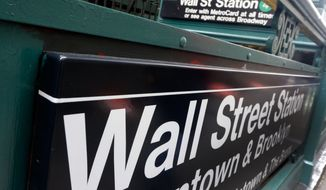 FILE - This Oct. 2, 2014 file photo shows the Wall Street subway stop on Broadway, in New York's Financial District. Stocks turned higher in European trading on Friday, April 24, 2015, despite a lack of progress on Greece's bailout.  (AP Photo/Richard Drew)