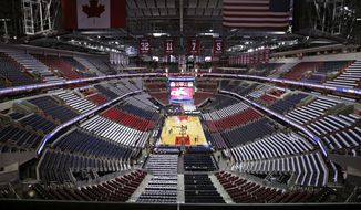 The Verizon Center is decorated with T-shirts on the seats before Game 3 in the first round of the NBA basketball playoffs between the Washington Wizards and the Toronto Raptors, Friday, April 24, 2015, in Washington. (AP Photo/Alex Brandon)