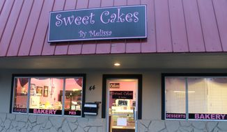 This Feb. 5, 2013, photo shows Sweet Cakes by Melissa in Gresham,Ore. An administrative law judge proposed Friday, April 24, 2015, that the owners of the suburban Portland bakery pay $135,000 to a lesbian couple who were refused service more than two years ago. The judge, Alan McCullough, ruled in January that Sweet Cakes by Melissa discriminated against Laurel and Rachel Bowman-Cryer by refusing to bake them a wedding cake. The bakers cited their religious beliefs in a case that has been cited in the national debate over religious freedom and discrimination against gays. (Everton Bailey Jr./The Oregonian via AP)