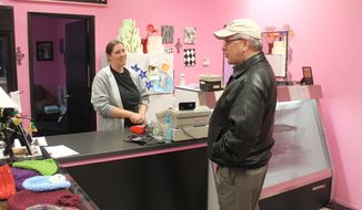 Melissa Klein, co-owner of Sweet Cakes by Melissa in Gresham,Ore., tells a customer  that the bakery has sold out of baked goods to sell for the day, Feb. 5, 2013. (Associated Press) ** FILE **