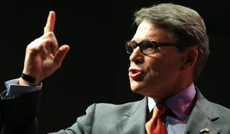 Former Texas Gov. Rick Perry speaks at the Iowa Faith & Freedom 15th Annual Spring Kick Off, in Waukee, Iowa, Saturday, April 25, 2015. (AP Photo/Nati Harnik) ** FILE **