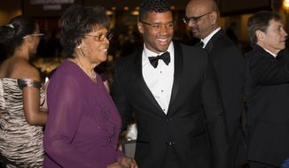Seattle Seahawks quarterback Russell Wilson, right, stands with his grandmother Carolyn Wilson during the White House Correspondents' Association dinner at the Washington Hilton on Saturday, April 25, 2015, in Washington. (AP Photo/Evan Vucci)