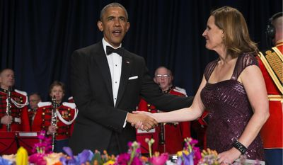 President Barack Obama, left, is greeted by White House Correspondents Association president Christi Parsons during the White House Correspondents' Association dinner at the Washington Hilton on Saturday, April 25, 2015, in Washington. (AP Photo/Evan Vucci)