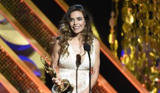 Amelia Heinle accepts the award for outstanding actress in a drama series at the 42nd annual Daytime Emmy Awards at Warner Bros. Studios on Sunday, April 26, 2015, in Burbank, Calif. (Photo by Chris Pizzello/Invision/AP)
