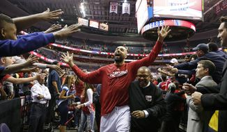 Washington Wizards forward Drew Gooden (90) celebrates with the fans after Game 4 in the first round of the NBA basketball playoffs against the Toronto Raptors, Sunday, April 26, 2015, in Washington. The Wizards won 125-94 to complete the first sweep of a seven-game series in club history, and advancing them to the second-round. (AP Photo/Alex Brandon)