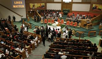 Friends and family of Freddie Gray gather around his casket before his funeral, Monday, April 27, 2015, at New Shiloh Baptist Church in Baltimore. Gray died from spinal injuries about a week after he was arrested and transported in a Baltimore Police Department van. (AP Photo/Patrick Semansky)
