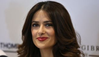 "Mexican-American actress Salma Hayek smiles during a press conference, for her film, ""The Prophet,"" an animated feature film she co-produced, in Beirut, Lebanon, Monday, April 27, 2015. In her first visit to her ancestral homeland, Hayek, whose paternal grandfather was Lebanese and immigrated to Mexico, visited the picturesque mountain village of Bcharre in northern Lebanon on Sunday to pay homage to Khalil Gibran, the Lebanese-born poet who wrote ""The Prophet,"" the book on which the film is based. (AP Photo/Hussein Malla)"