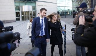 Daniel McArthur, general manager of Ashers Baking Company, and his wife Amy McArthur leave Laganside court, Northern Ireland, Thursday March 26, 2015. Ashers Baking Company faces a discrimination row after refusing to bake a cake supporting gay marriage. (AP Photo/Peter Morrison)