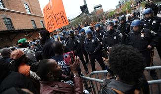 Protestors rally at Oriole Park at Camden Yards during a march for Freddie Gray on Saturday. (Associated Press)