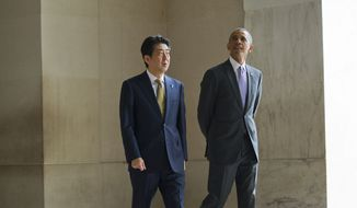 President Barack Obama and Japanese Prime Minister Shinzo Abe visit the Lincoln Memorial on the National Mall in Washington, Monday, April 27, 2015. (AP Photo/Pablo Martinez Monsivais)