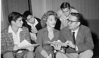 """In this Dec. 11, 1959, file photo, Steve Allen, right, wife, Jayne Meadows, and his sons, from left, Steve Jr., 15, David, 9, and Brian, 12, rehearse for their roles in """"The Steve Allen Show"""" on the NBC-TV network in New York. The actress and TV personality, Meadows, who often teamed with her husband Allen, has died at age 95. (AP Photo, File)"""