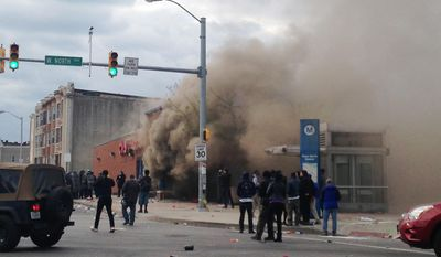 Smoke billows from a CVS Pharmacy store in  Baltimore on Monday, April 27, 2015. Demonstrators clashed with police after the funeral of Freddie Gray. Gray died from spinal injuries about a week after he was arrested and transported in a Baltimore Police Department van. (AP Photo/Juliet Linderman) ** FILE **