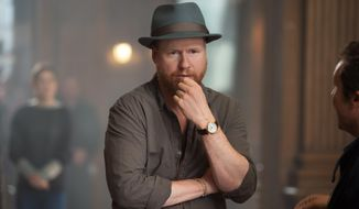 "In this photo provided by Disney/Marvel, director Joss Whedon works on set for the film, ""Avengers: Age Of Ultron.""  The movie releases in the United States, on May 1, 2015. (Jay Maidment/ Disney/Marvel via AP)"