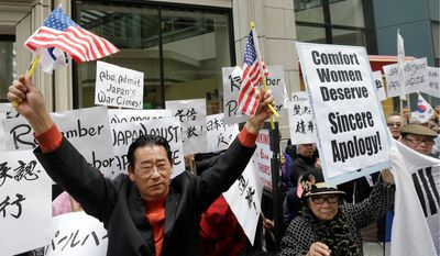 Chinese-Americans and Korean-Americans protested outside of the Japanese Consulate in San Francisco, calling on Prime Minister Shinzo Abe to apologize. (Associated Press)